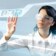 Pretty young lady using new technologies (outstanding business people in interiors / interfaces series)